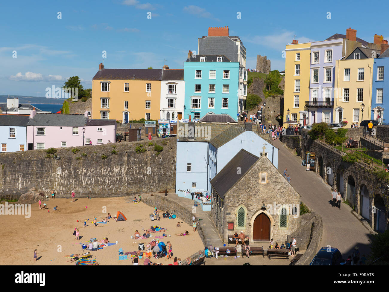 Tenby town Pembrokeshire Wales uk in summer with beach tourists and visitors and blue sky - Stock Image