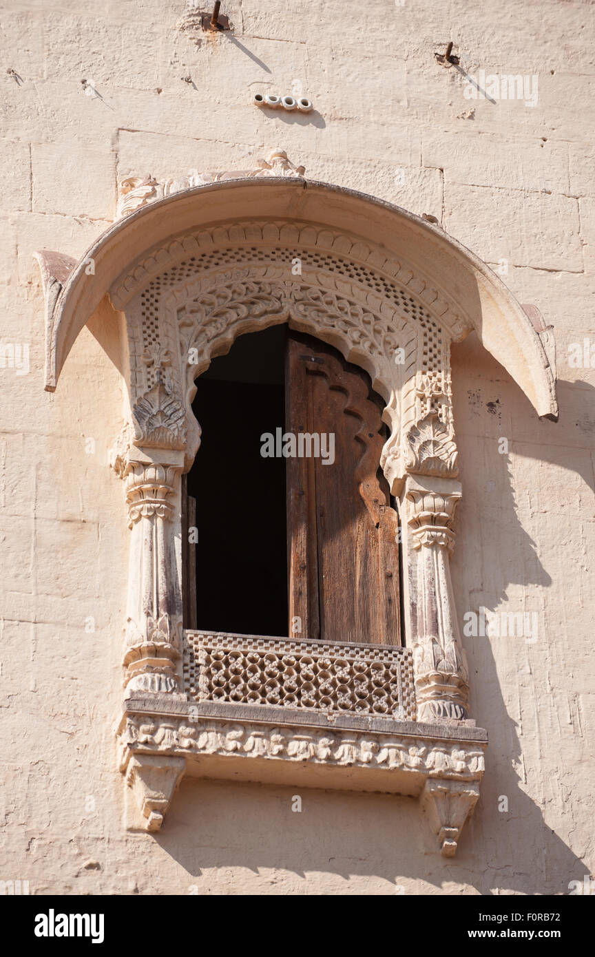Jodhpur, India. Mehrangarh sandstone hill fort of the Marwar rulers. White carved window. - Stock Image