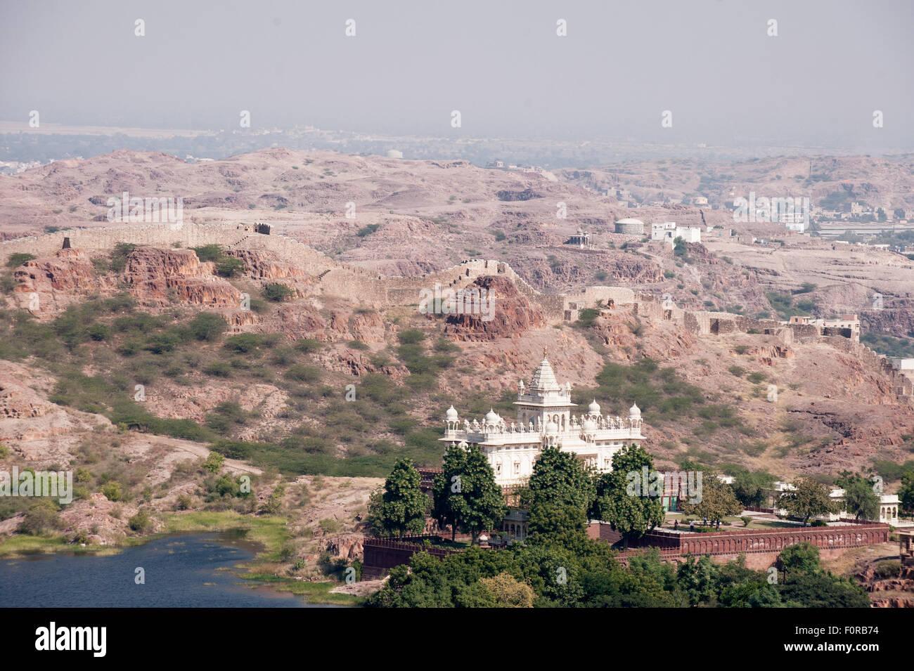 Jodhpur, India. Jaswant Thada  mausoleum. White marble cenotaph, in memory of the Maharaja. Arid landscape. - Stock Image