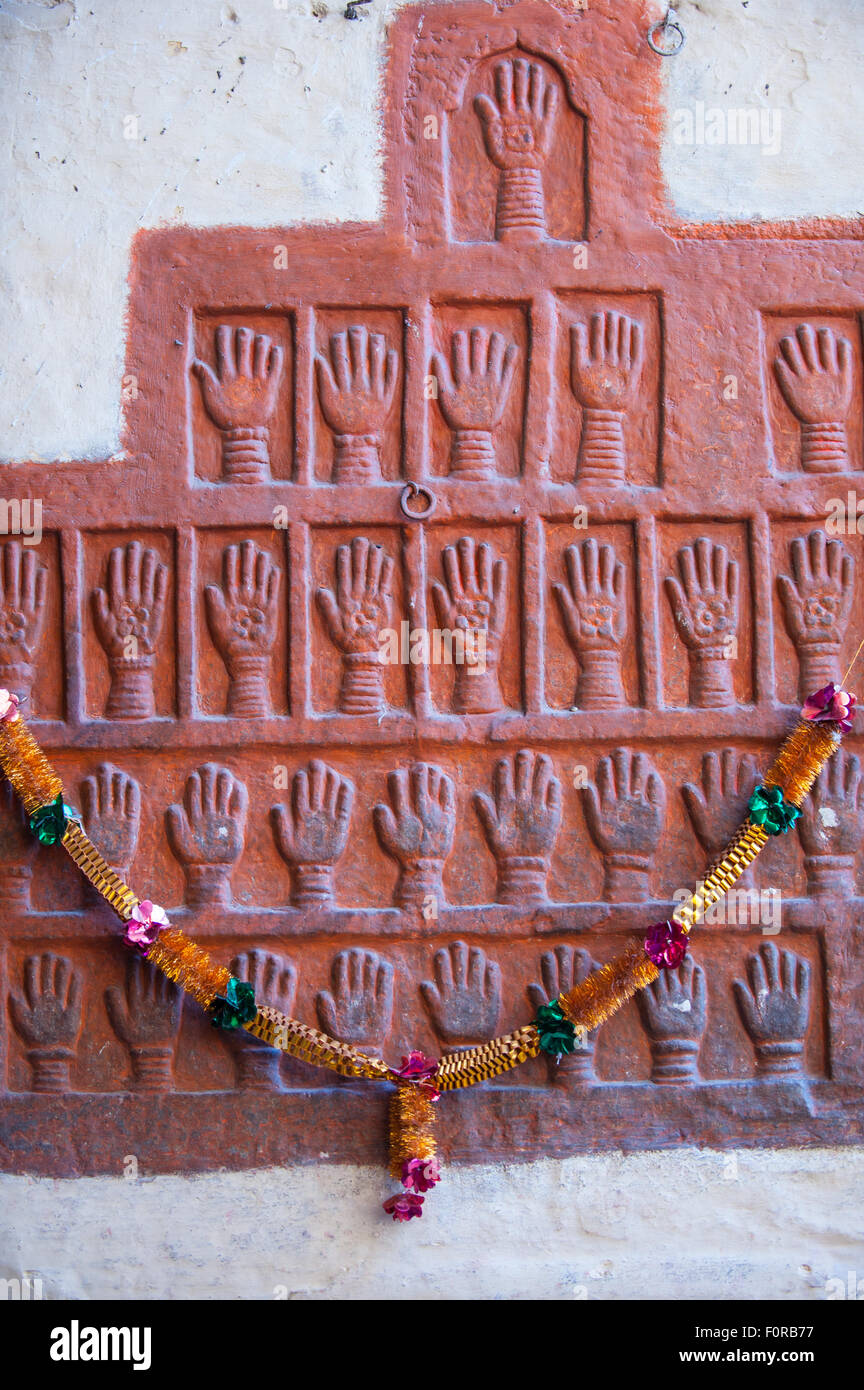 Jodhpur, India. Mehrangarh fort of the Marwar rulers. Red hand prints of the wives of Maharajahs subjected to suttee - Stock Image