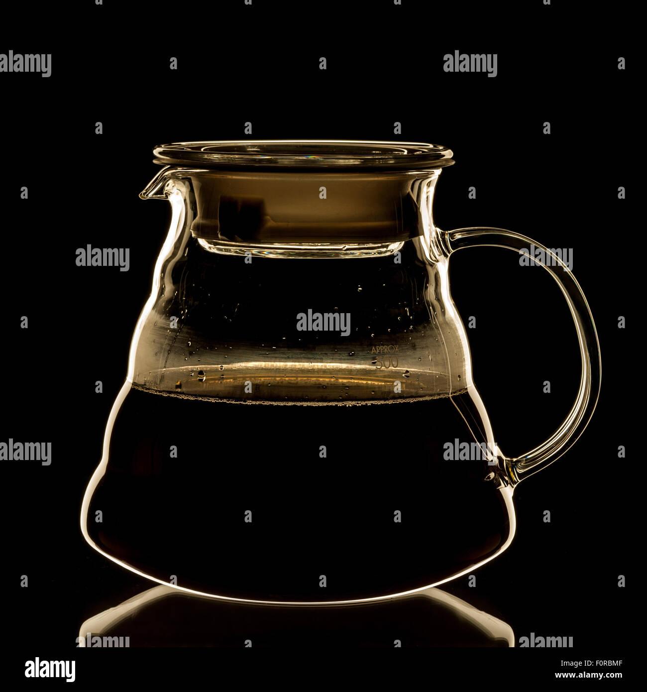 Brewed coffee in glass jug - Stock Image