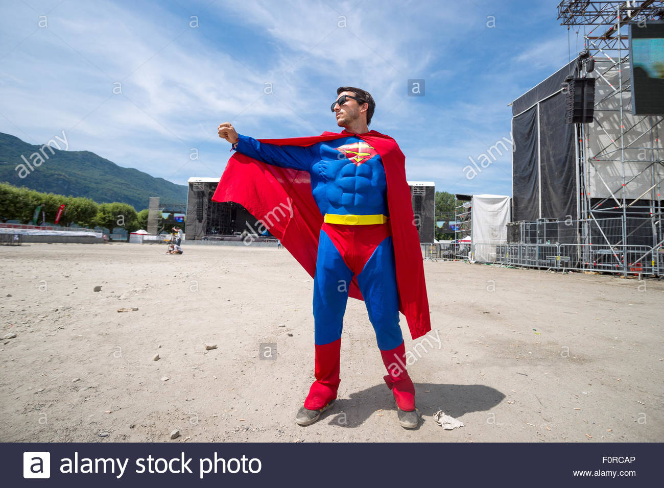 Superman landing in front of the stages at Musilac pop rock summer festival - Stock Image