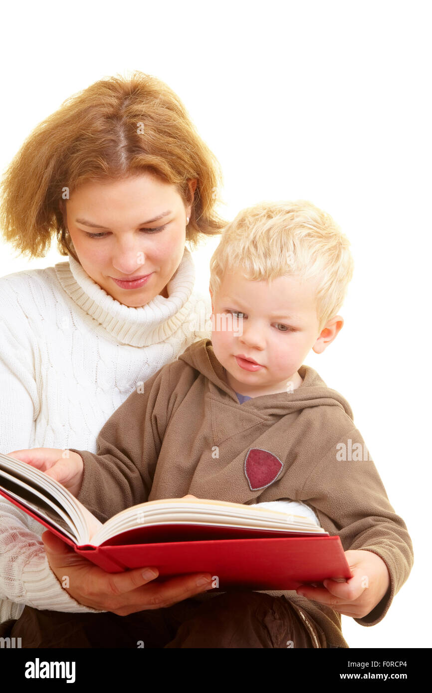 Mother reading a book with her son - Stock Image