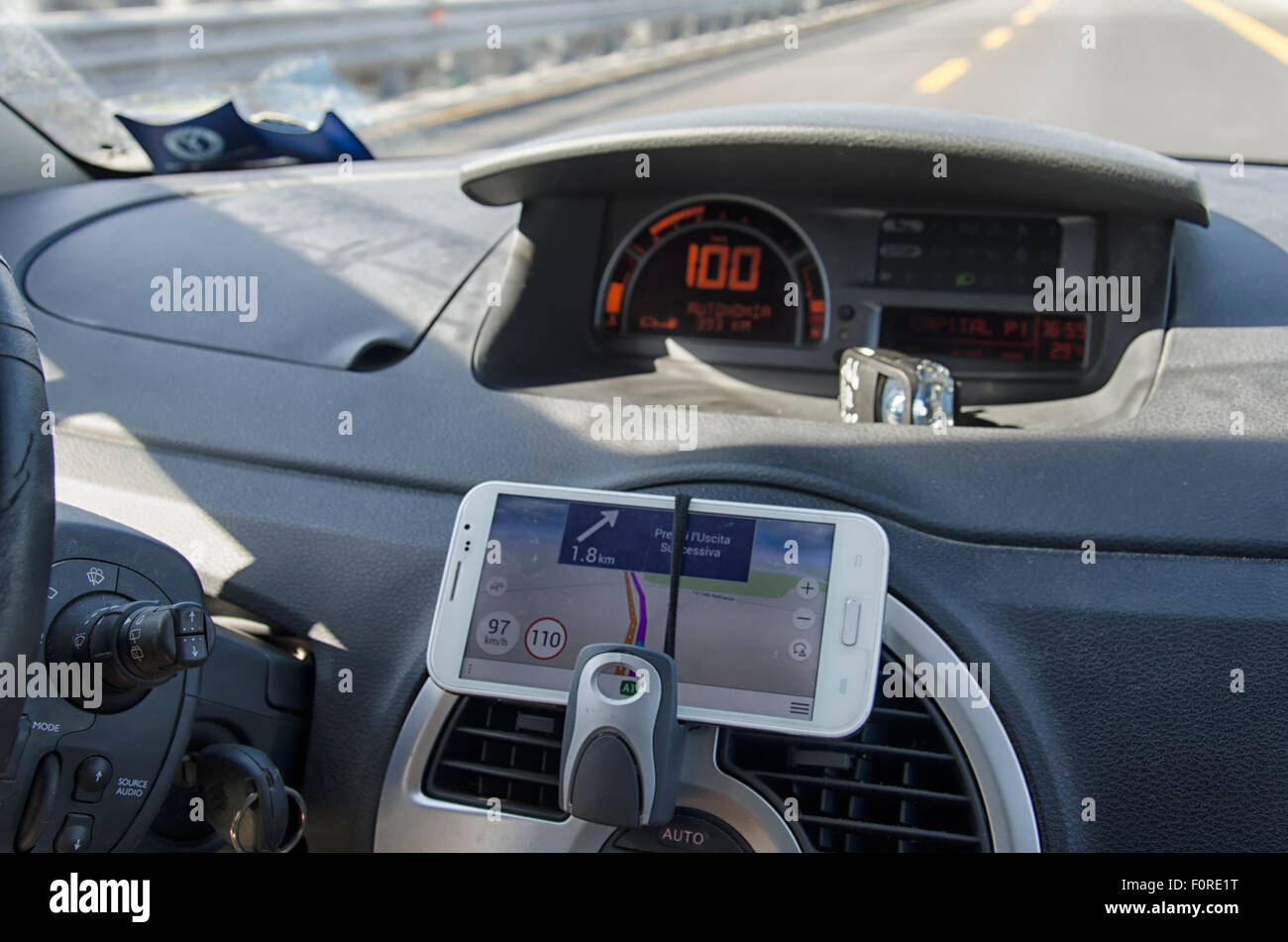 Phone use as a navigation system in the car - Stock Image