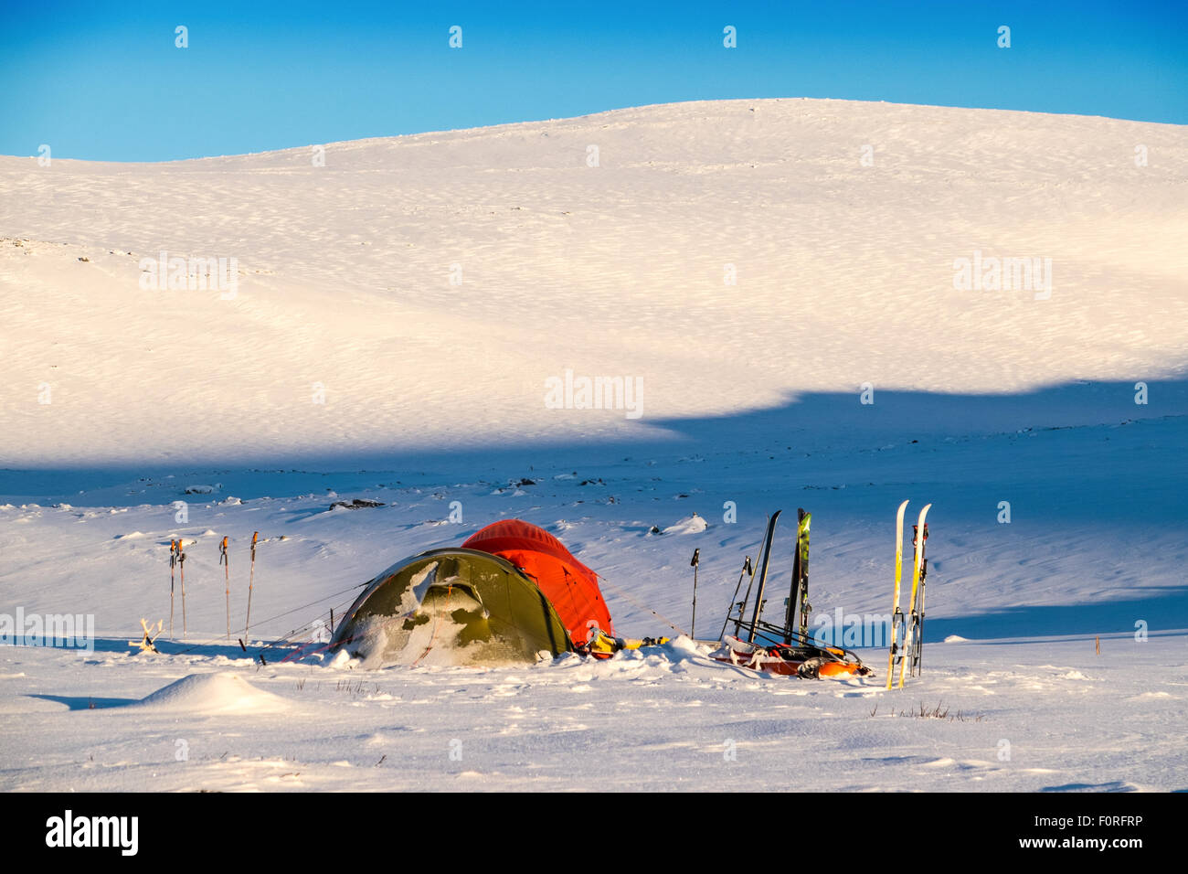 Ski-tourers  tents in the Dovre National Park, Norway - Stock Image