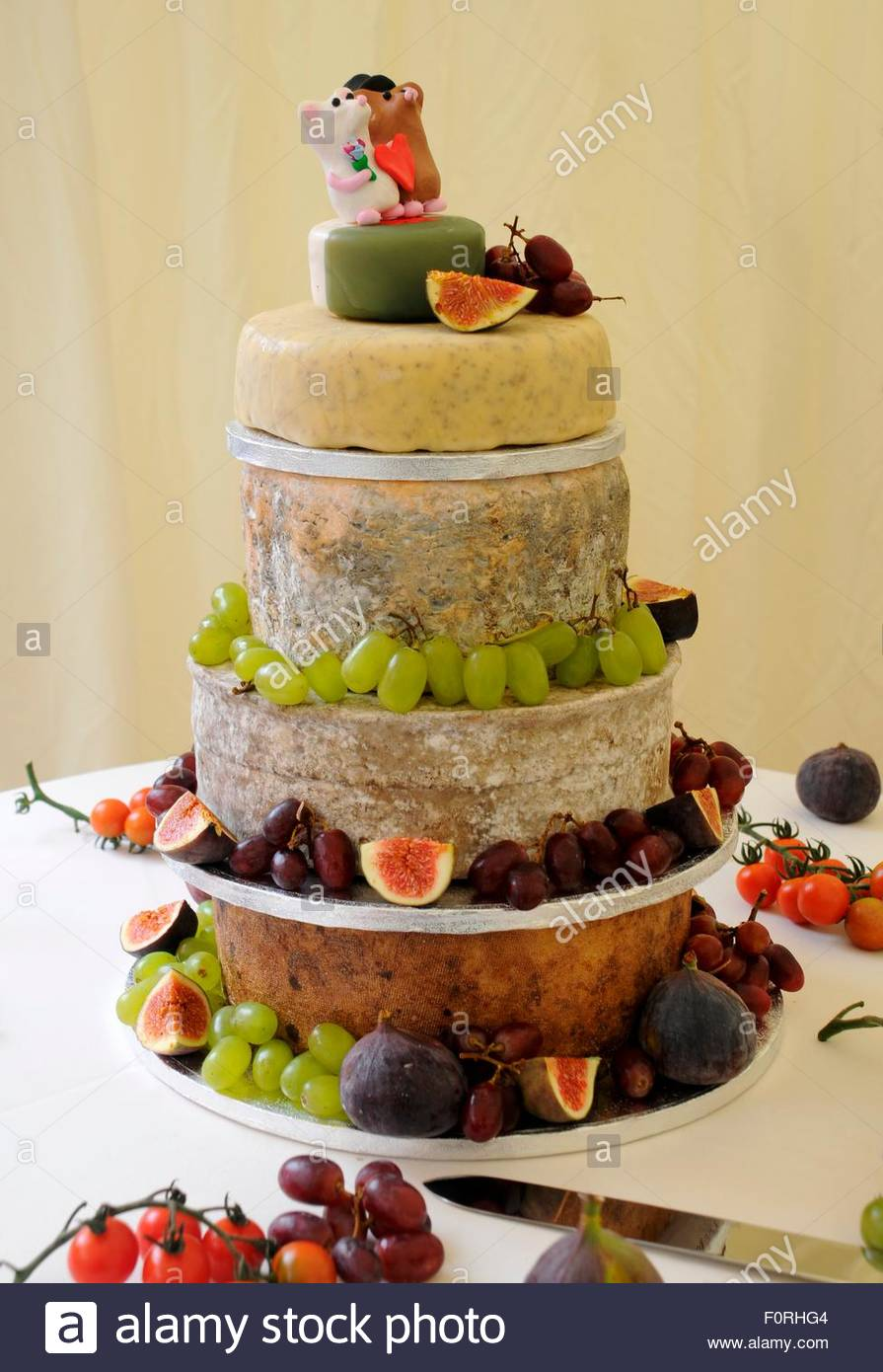 A wedding cake of cheese with fruit Stock Photo: 86570516 - Alamy