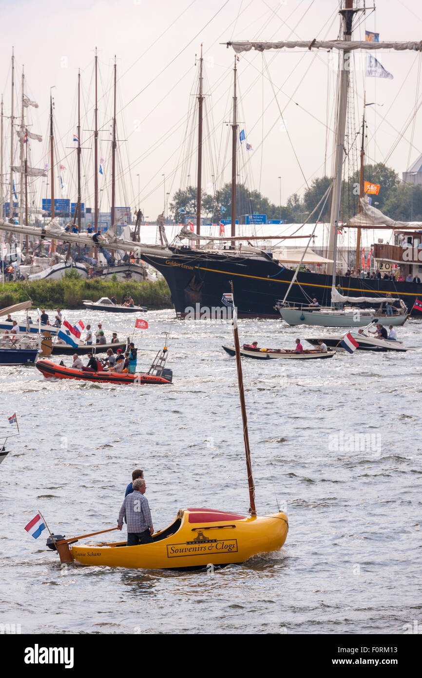 A small sailboat in the form of a traditional Dutch Clog during Amsterdam Sail 2015 - Stock Image