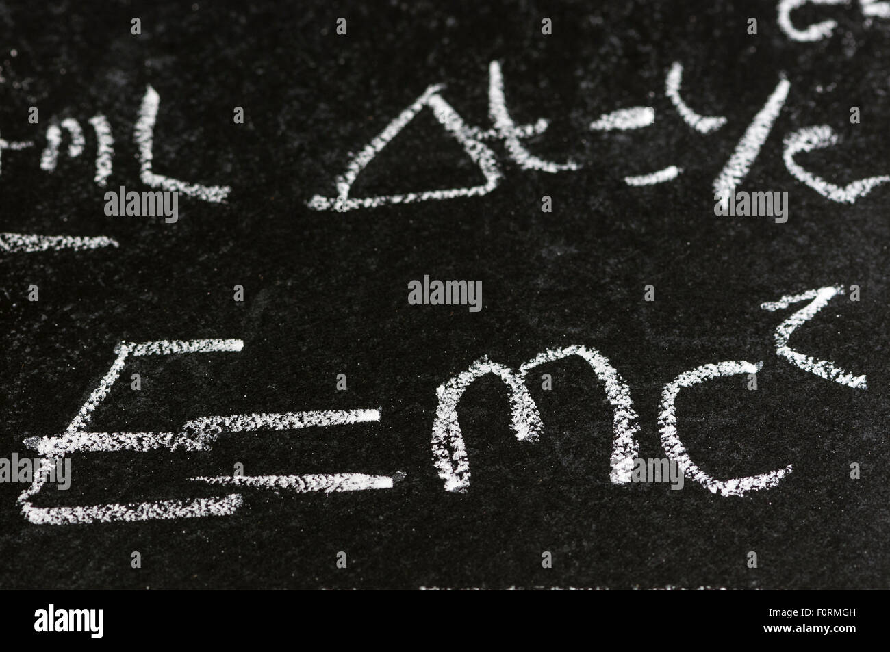 Mathematical derivation of E=mc^2 on a blackboard - Stock Image