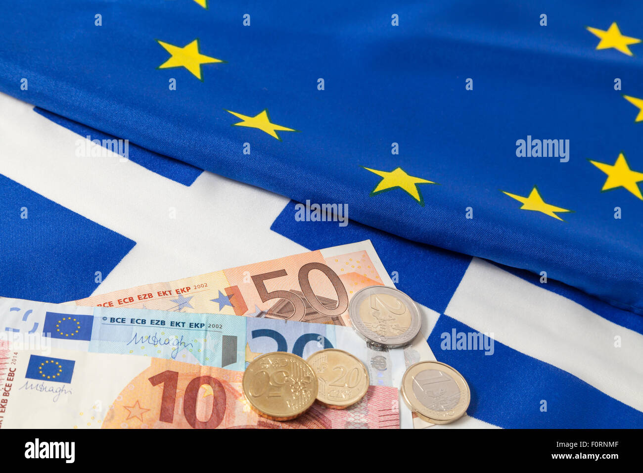 EU and greek flag and Euro cash - Stock Image