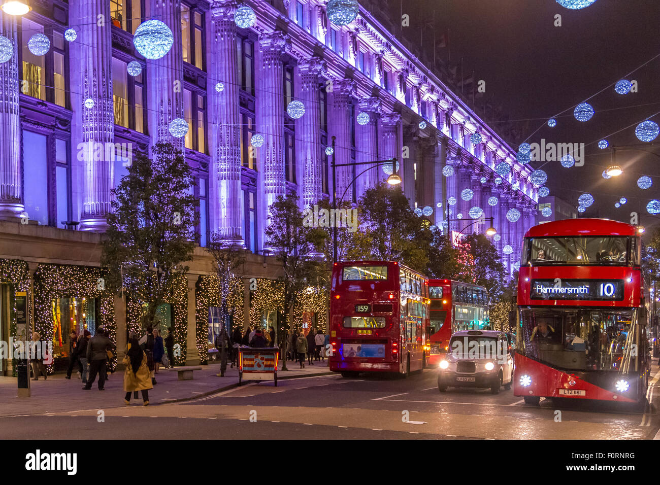London Buses outside Selfridges on Oxford St filled with Christmas shoppers at Christmas Time with the Oxford St - Stock Image