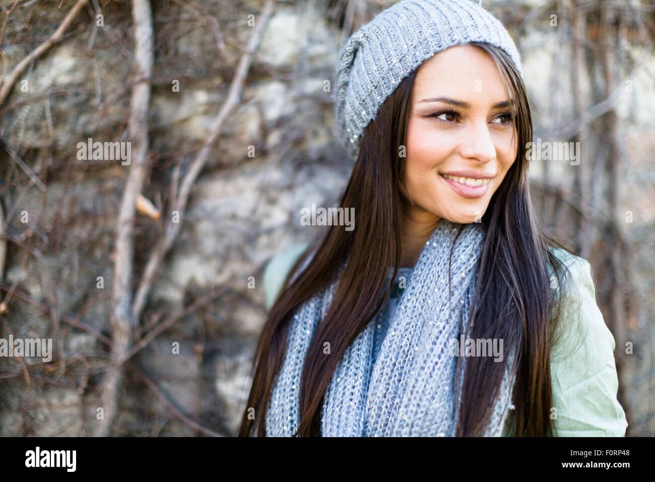 Portrait of a smiling  young woman in winter - Stock Image