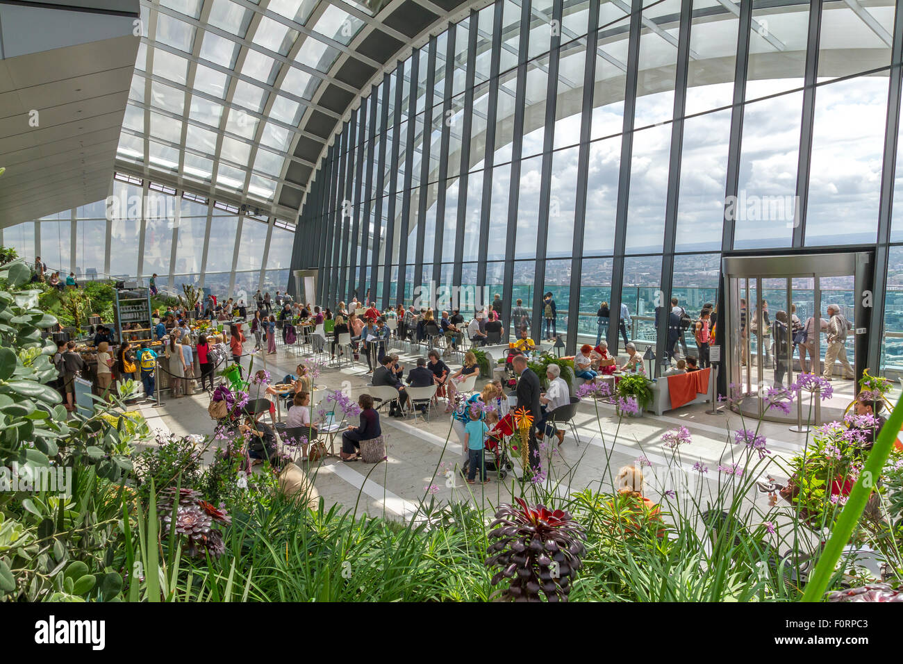 People visiting The Sky Garden and having drinks at The Sky Pod Bar at the top of 20 Fenchurch St,also known as - Stock Image