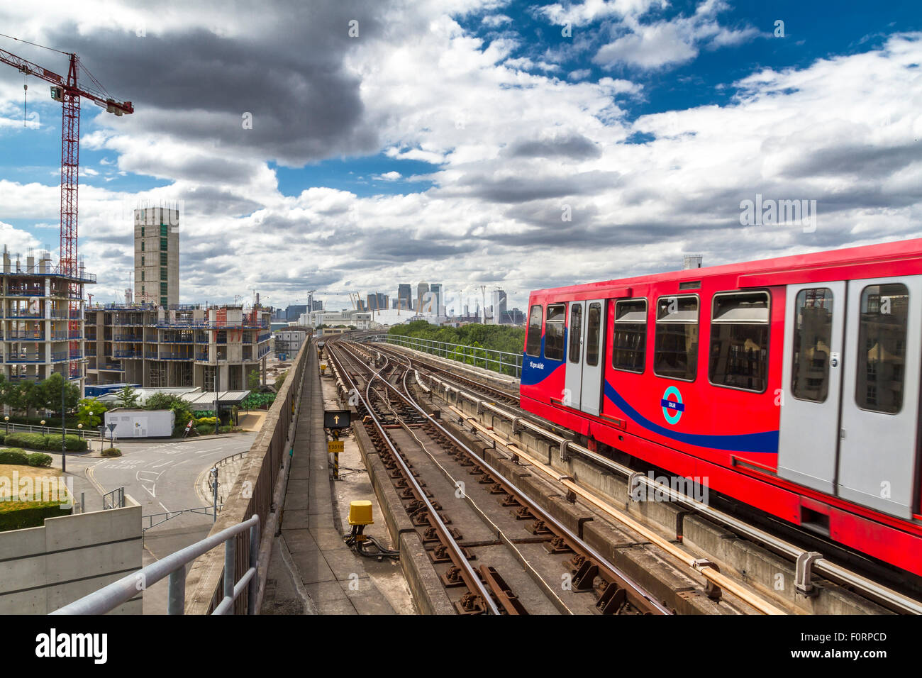 Canary Wharf From Pontoon Dock DLR Station ,with a DLR train leaving the station along the railway tracks - Stock Image