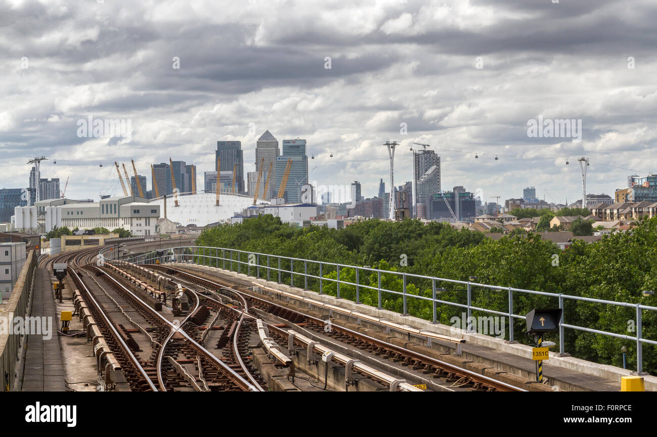 Canary Wharf From Pontoon Dock DLR Station With Railway tracks . - Stock Image