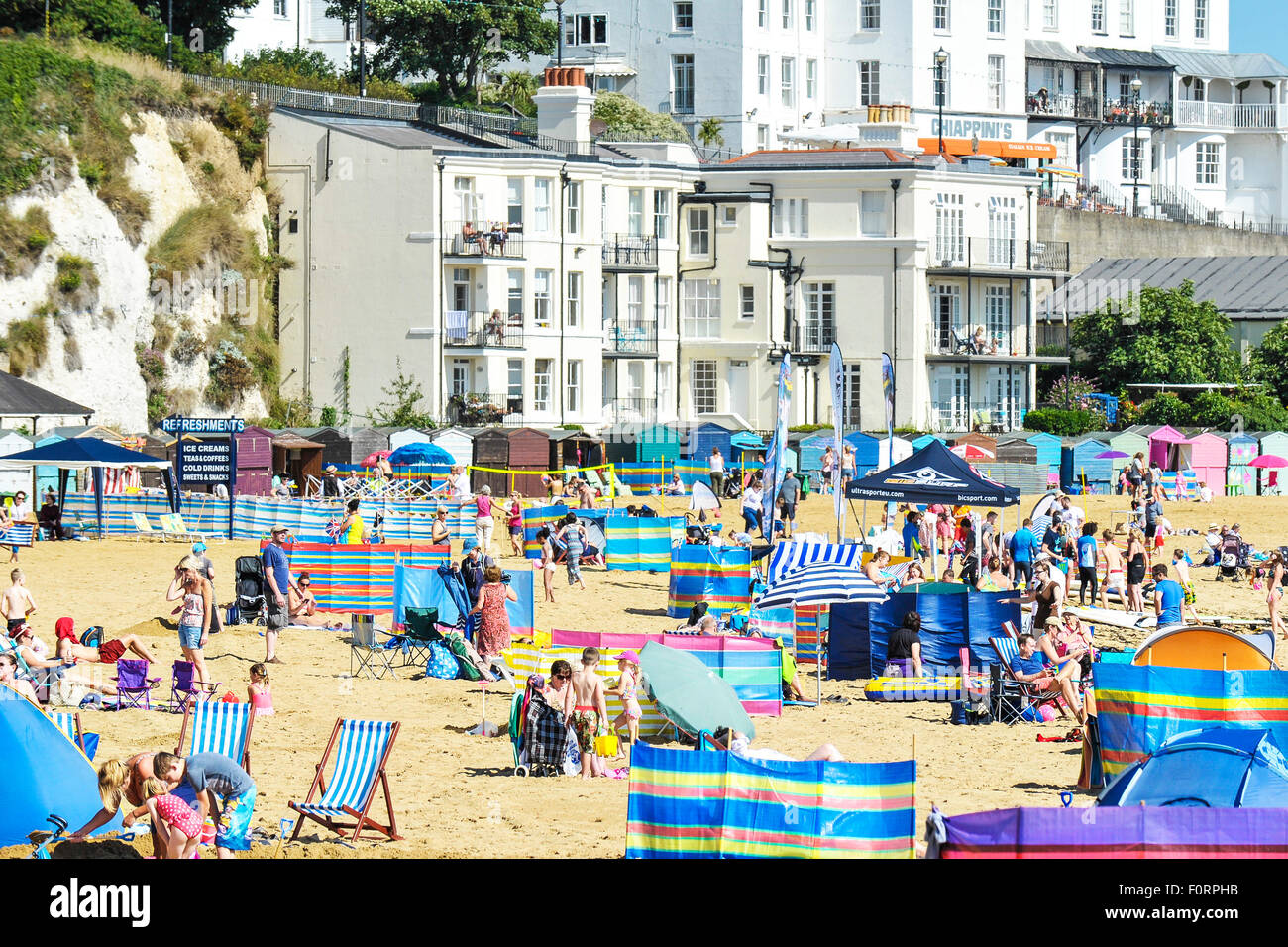 Holidaymakers on the beach at Viking Bay in Broadstairs, Kent. - Stock Image