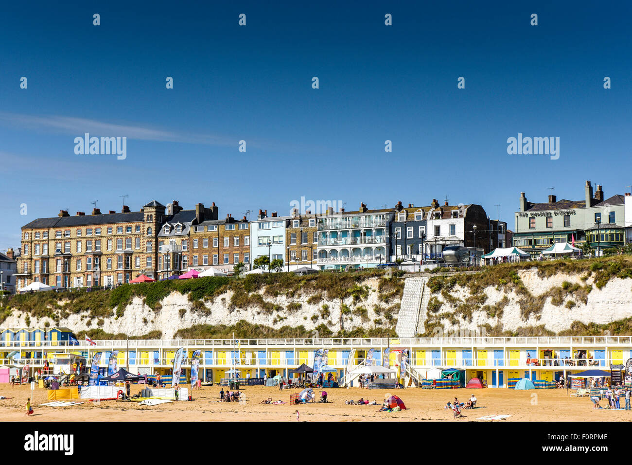 The seafront properties and beach at Viking Bay in Broadstairs, Kent. - Stock Image