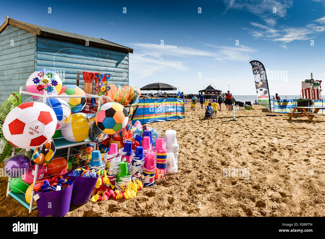 Colourful beach toys for sale on the beach at Viking Bay in Broadstairs, Kent. - Stock Image