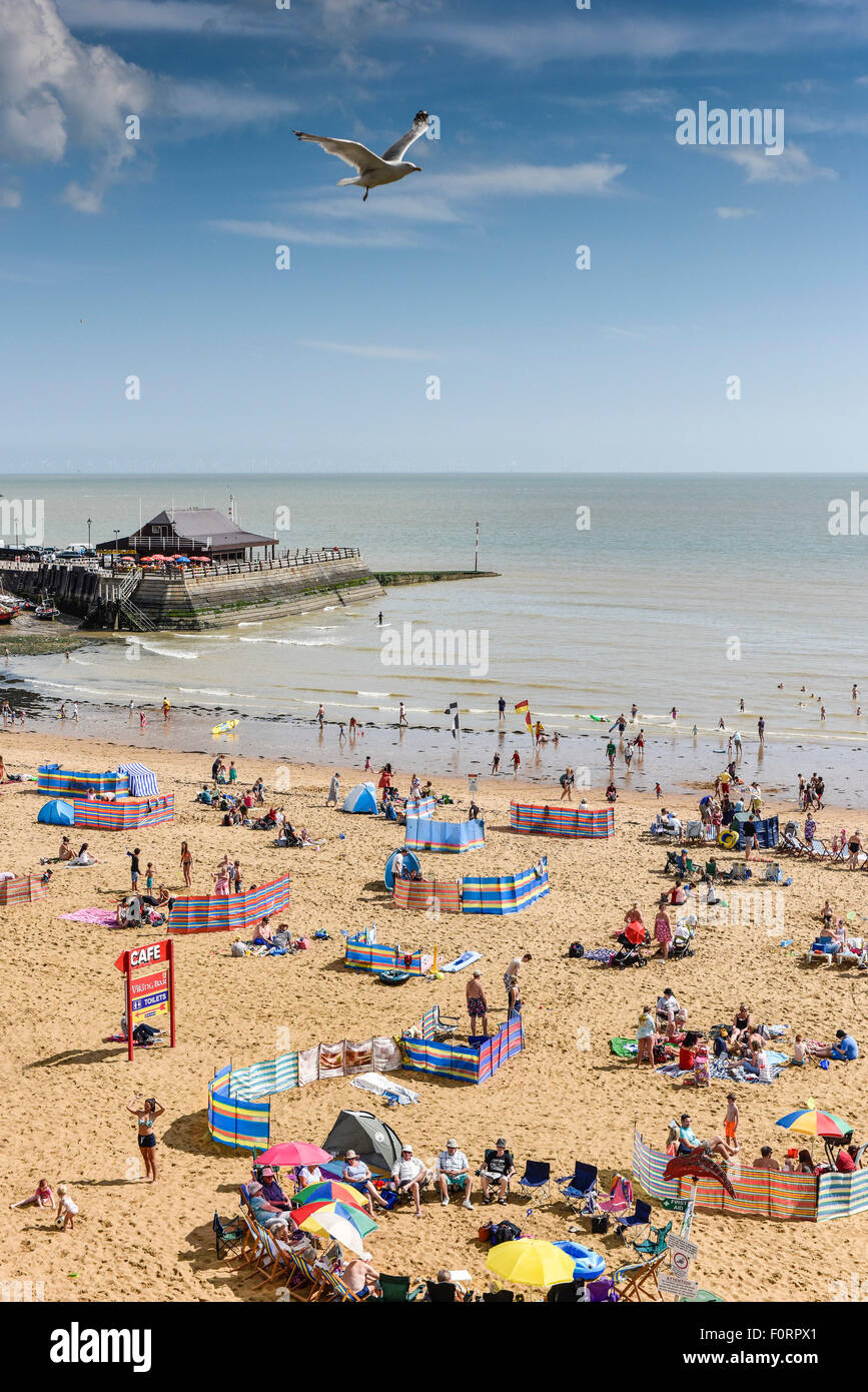 Holidaymakers on the beach at Viking Bay in Broadstairs, Kent. Stock Photo