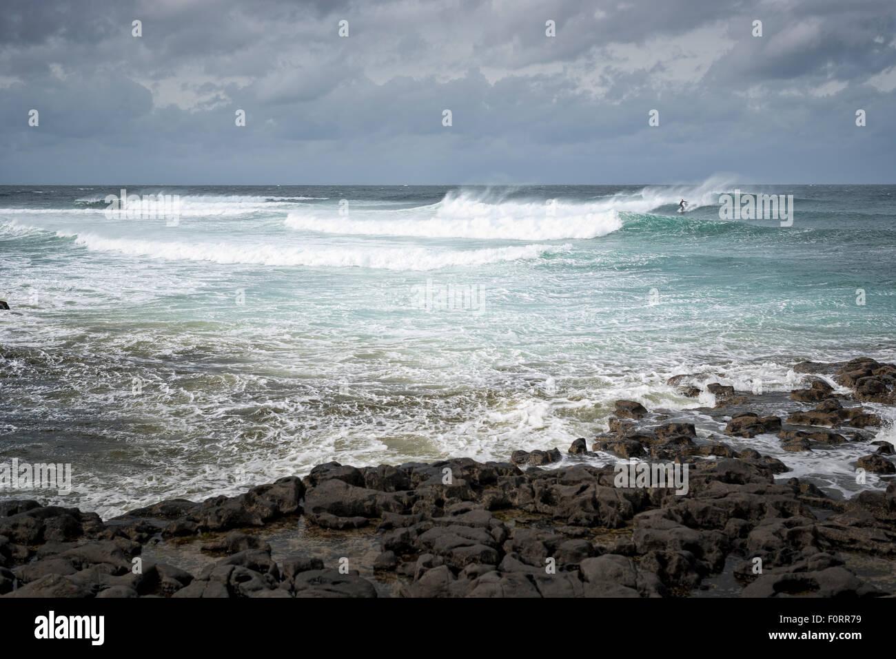Suffer riding a wave in the Atlantic of the west coast of Ireland, Easky, Co. Sligo. - Stock Image