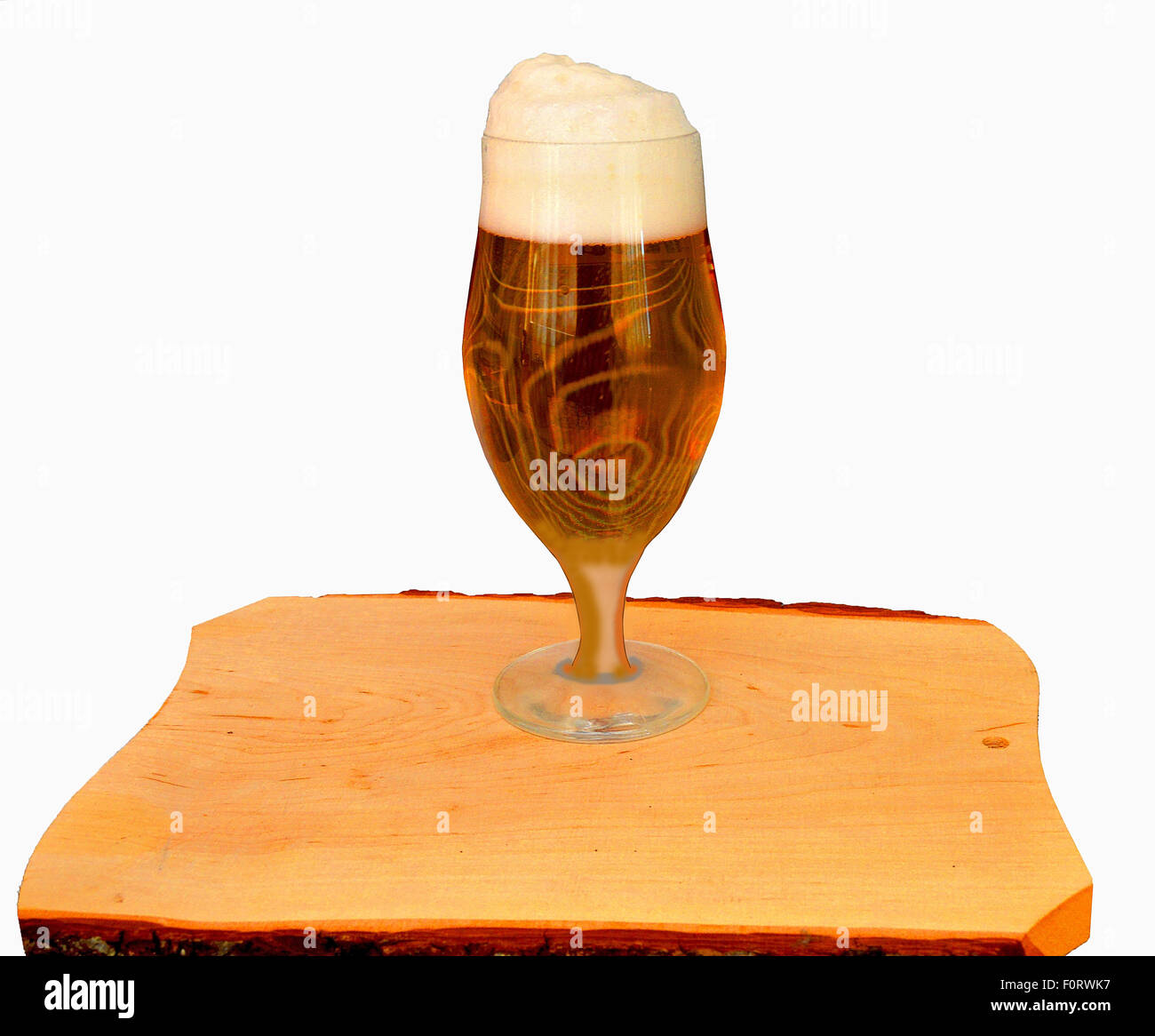 Beer by the glass on a wooden table - Stock Image