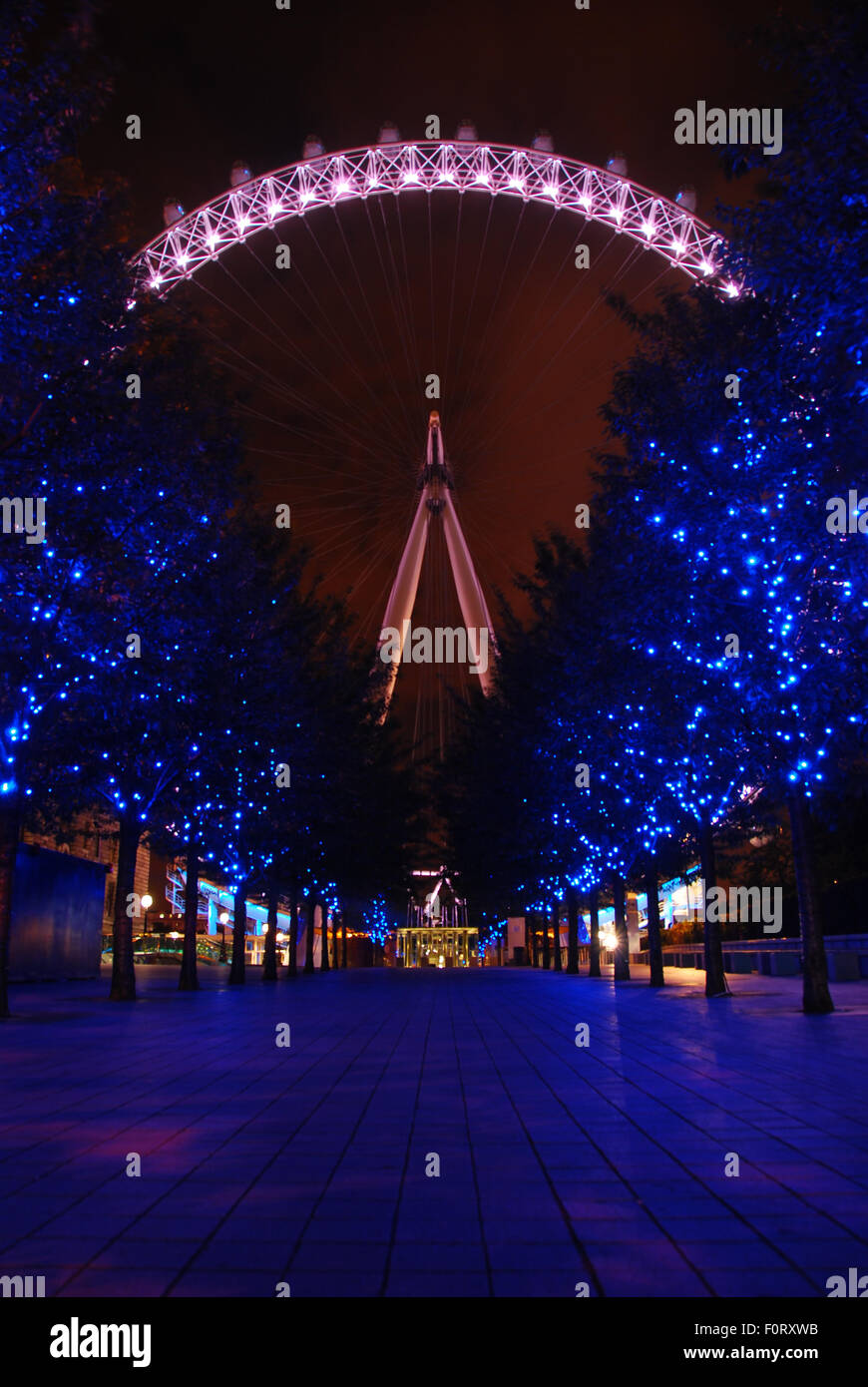 London, United Kingdom - July 18, 2009: London Eye, at night with blue light refection - Stock Image