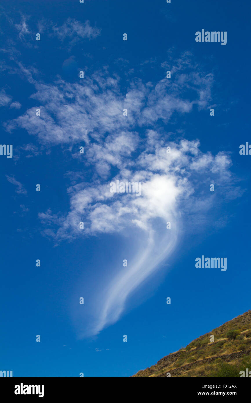 comma shaped cloud, trailing long wispy tail - Stock Image