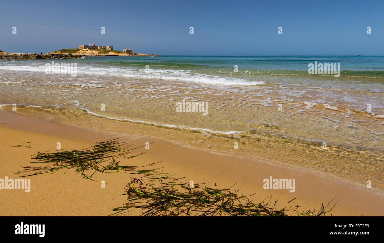 The island of currents. Correnti Island. Isola delle Correnti, Portopalo di Capo Passero, Sicily. - Stock Image