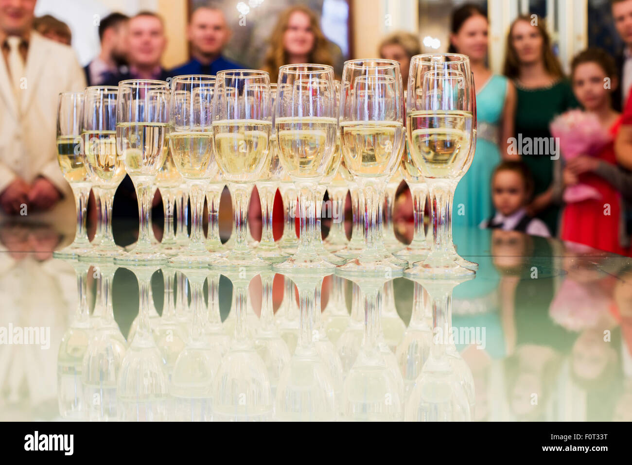 set standing on a table with glasses of champagne - Stock Image