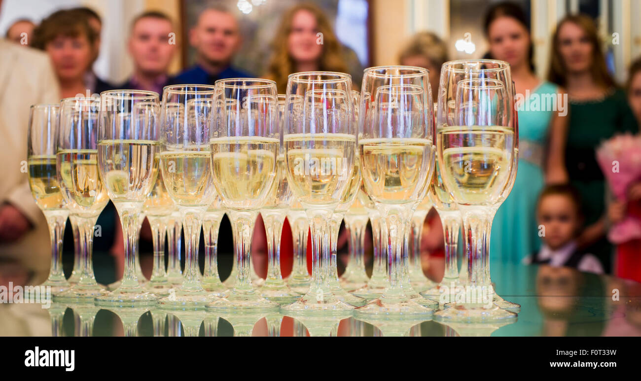 set standing on a table with glasses of champagne Stock Photo