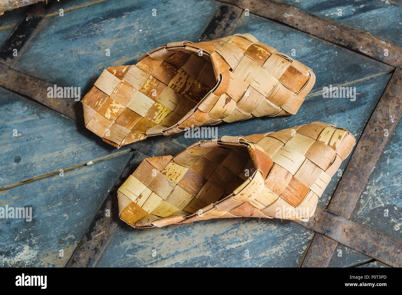 Russian National wicker shoes of birch bark (bast) - Stock Image
