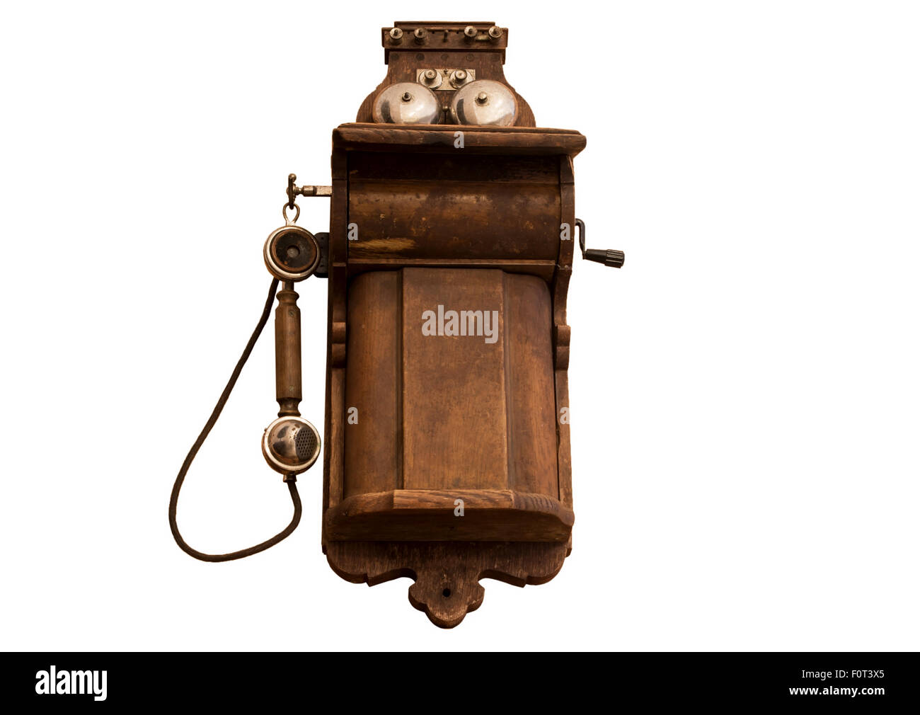 old wooden telephone on a white background - Stock Image