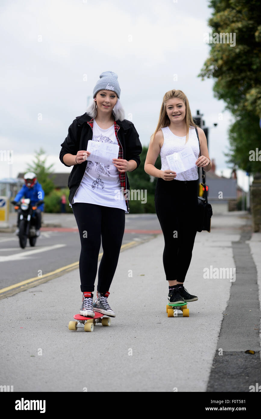 School girls Bethany Ogley (15) and Jasmine Brennan (15) collected their GCSE results on skateboards in Barnsley, - Stock Image