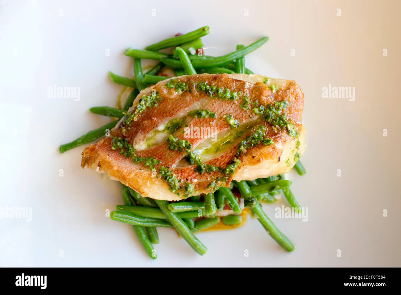 Red snapper fish and green beans Stock Photo