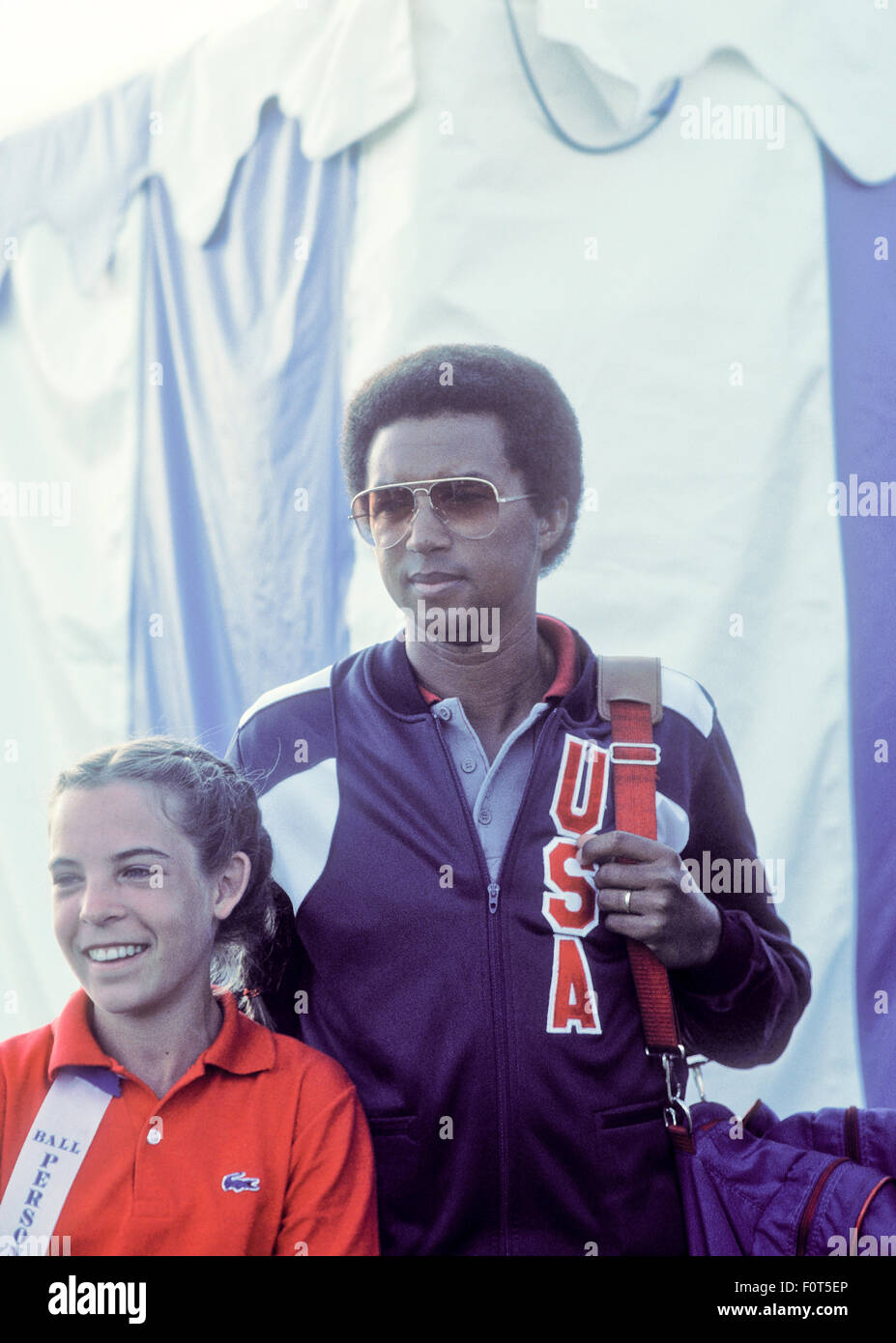 Arthur Ashe spectating at tennis tournament at La Costa Resort in Carlsbad, California in March, 1982. - Stock Image