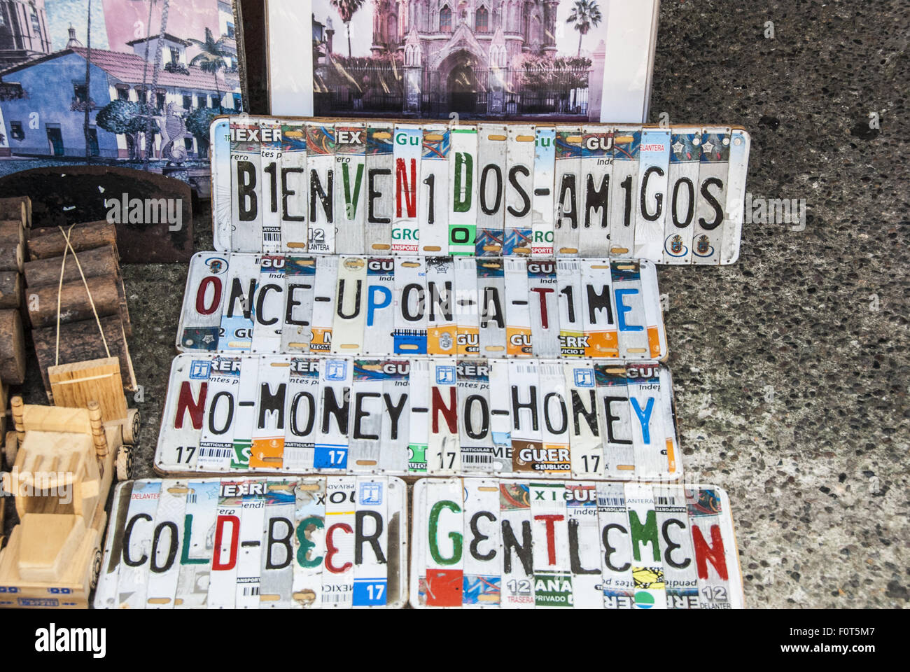 Signs made of cut license plates pieced together. Displayed in souvenir shop -  Puerto Vallarta on the Bay of Banderas, - Stock Image