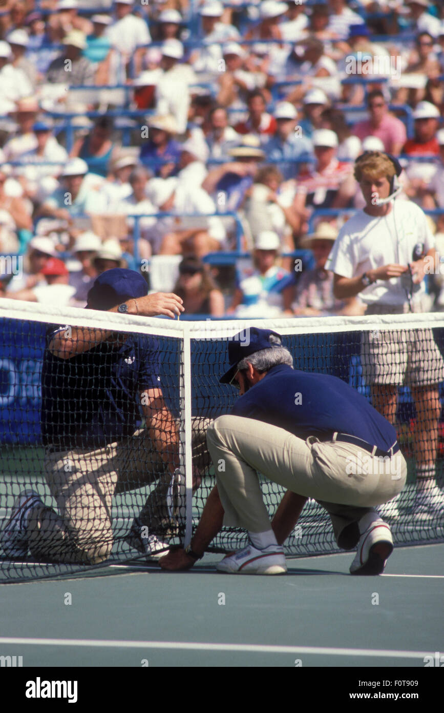 Officials measuring the net at the Newsweek Champions Cup tournament in Indian Wells, California in March 1988. - Stock Image