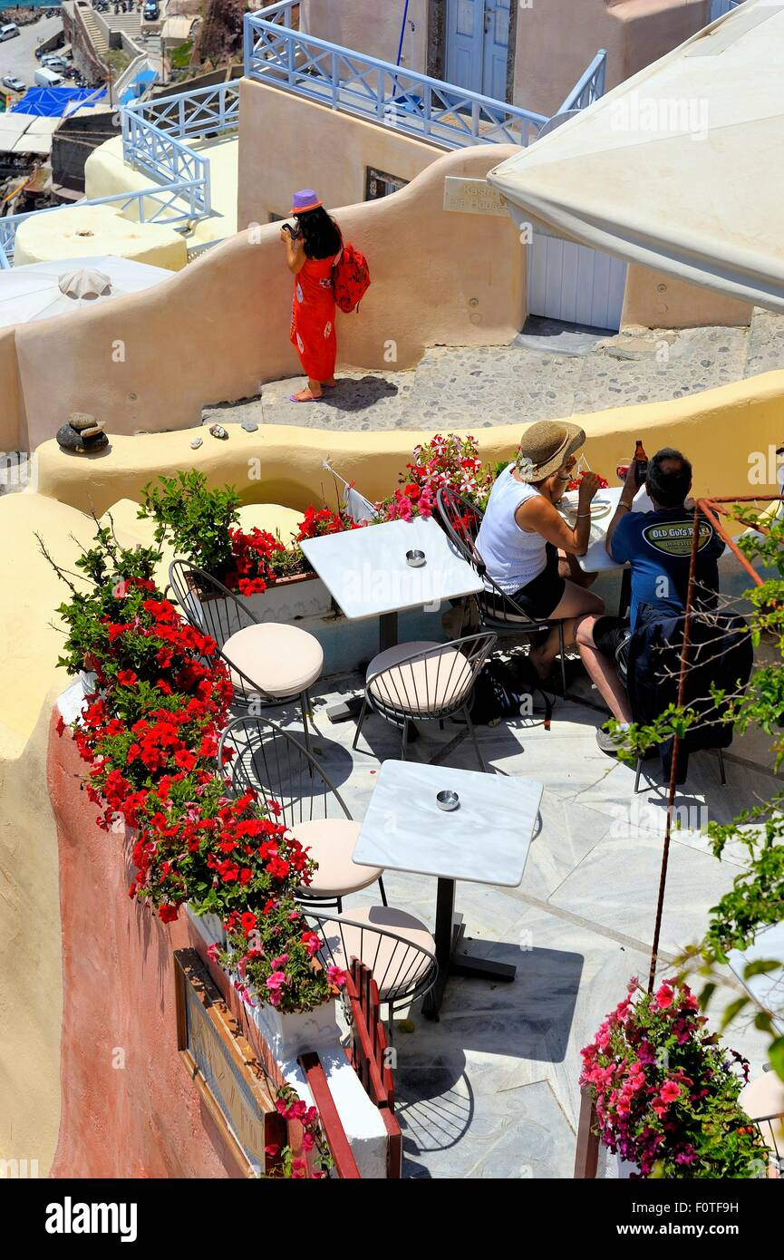 A rooftop cafe restaurant in the village of Oia Santorini Greece ...