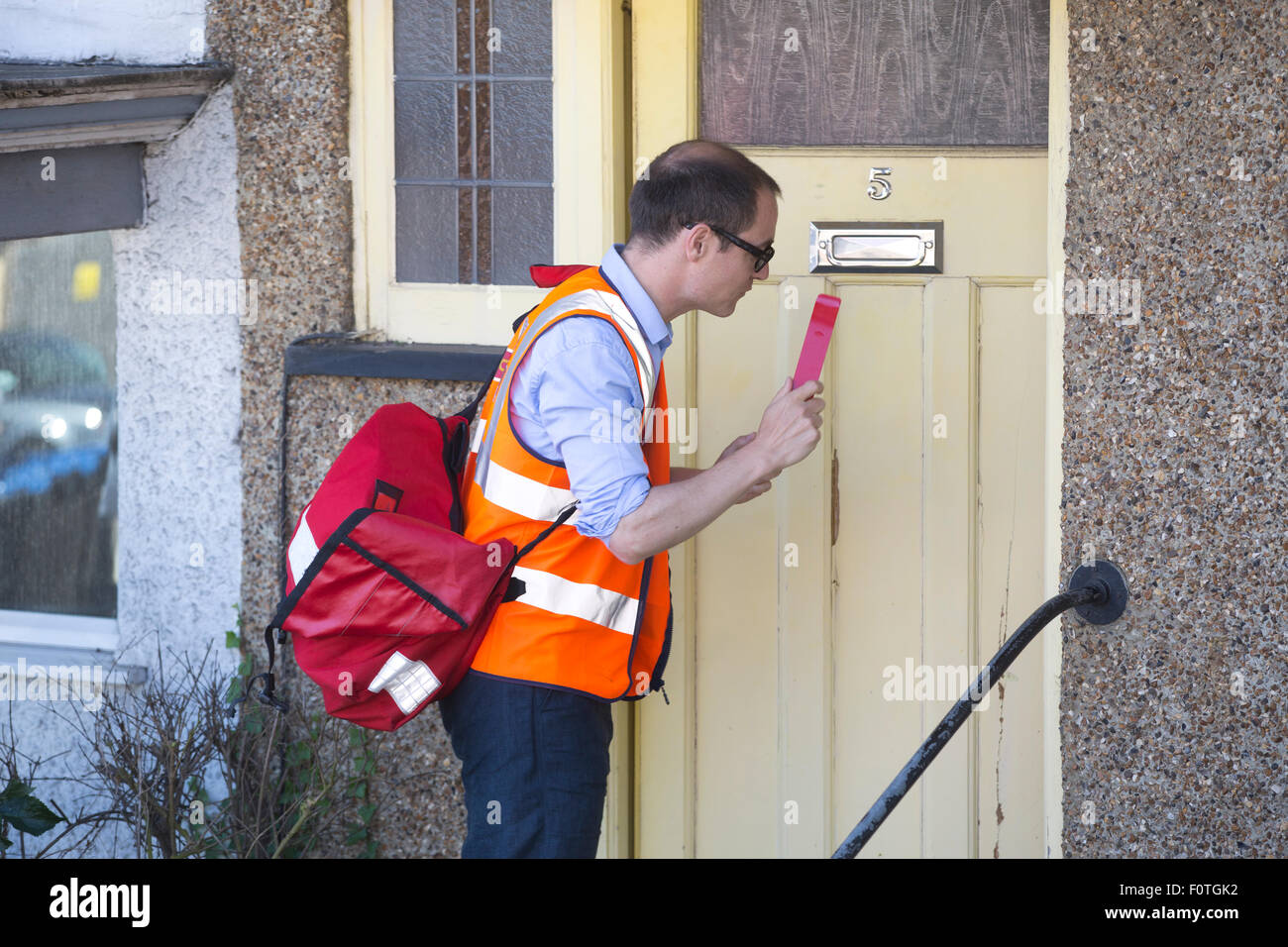 Royal Mail Postman Making A Delivery Using The Anti Dog
