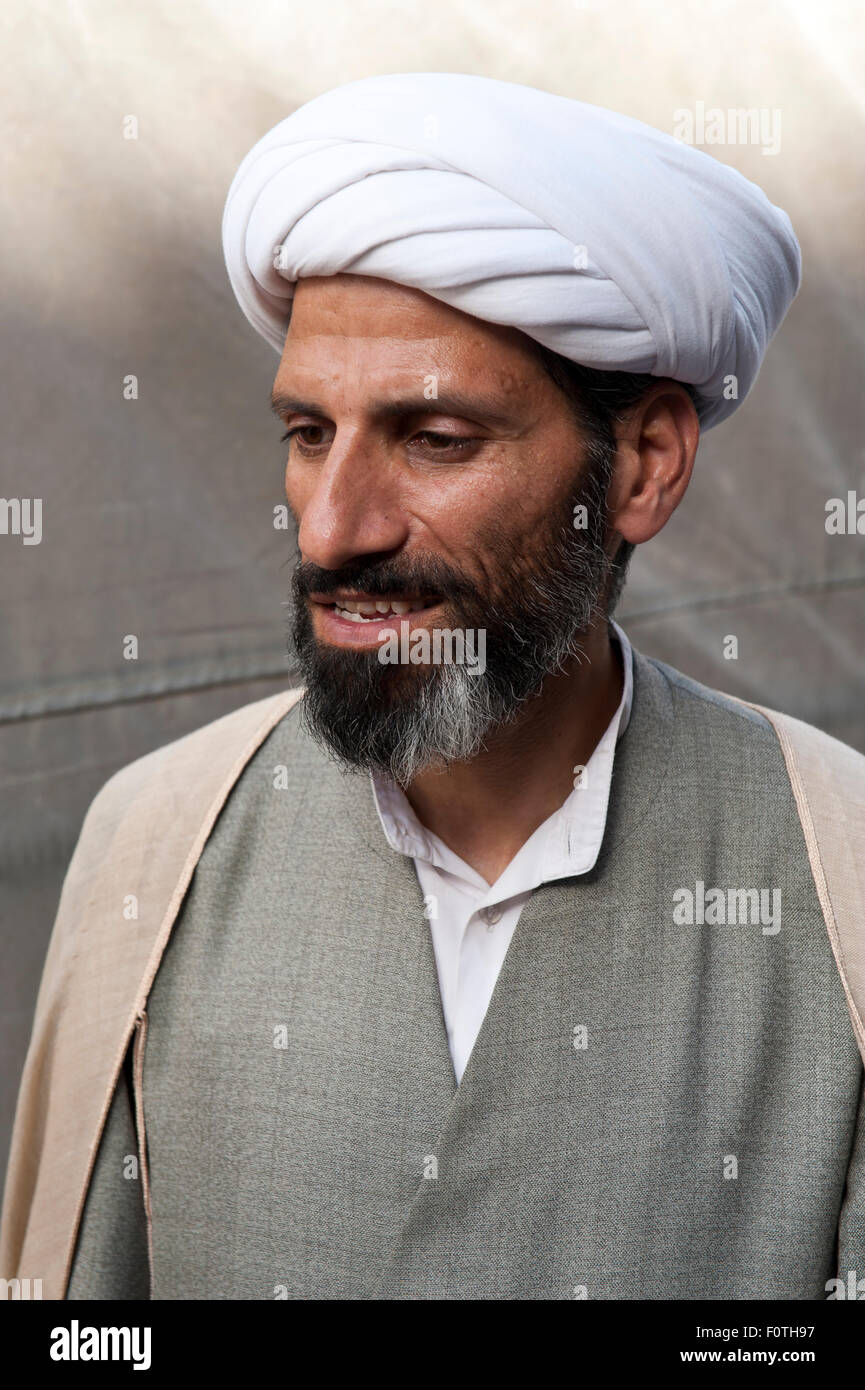Portrait, Persian, Iranian man with a white turban, Mullah, Qom, Iran - Stock Image