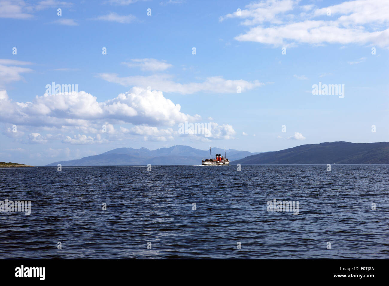 Waverley paddle steamer crossing Loch Fyne towards Tarbert with the hills of Arran in the background - Stock Image