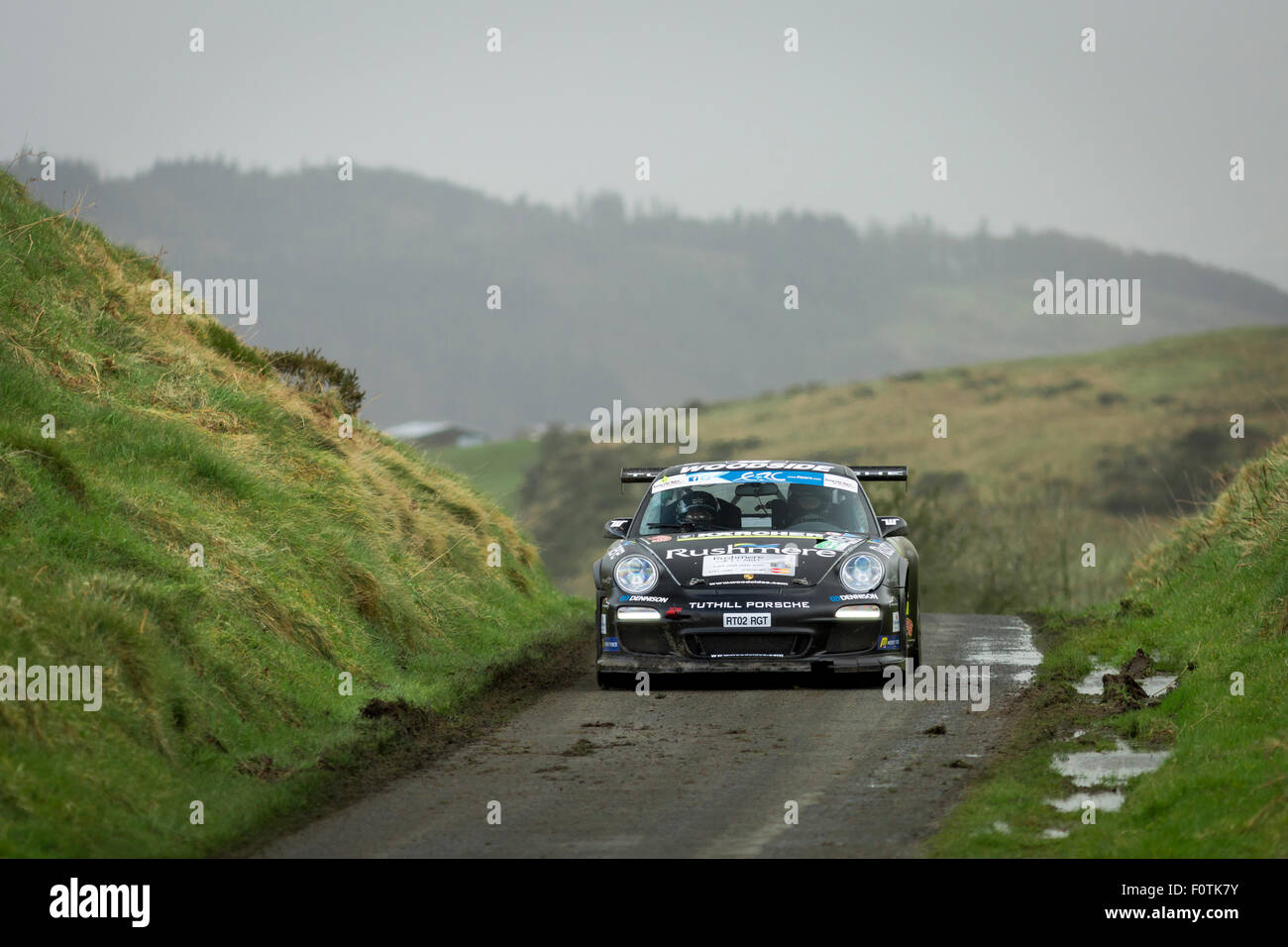 Porsche 911 Rally Car makes its way through the stages of the Circuit of Ireland Rally 2015. - Stock Image