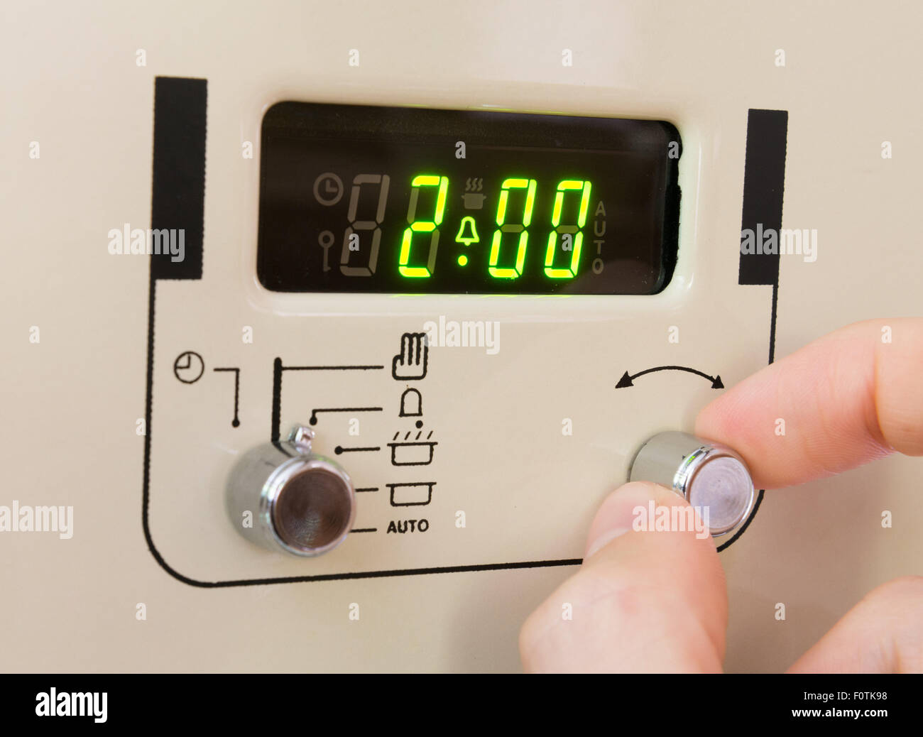 Setting a cooker timer to 2 hours - Stock Image