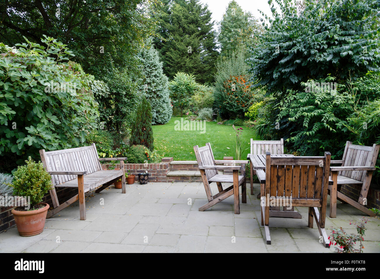 Backyard, patio and garden furniture in an English home - Stock Image