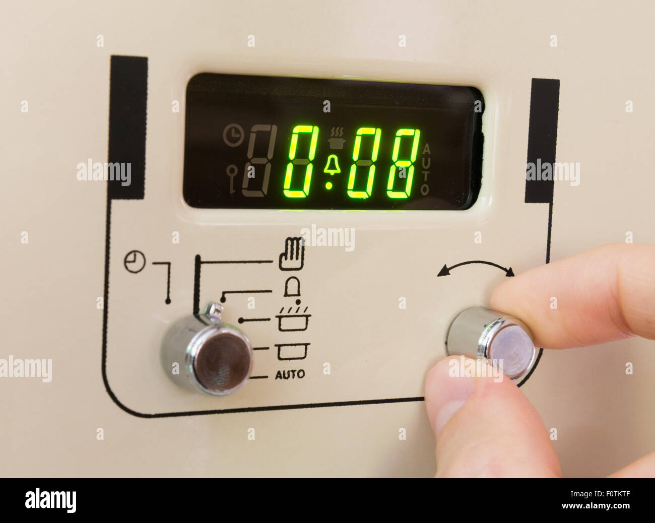 Setting a cooker timer to 8 minutes - Stock Image