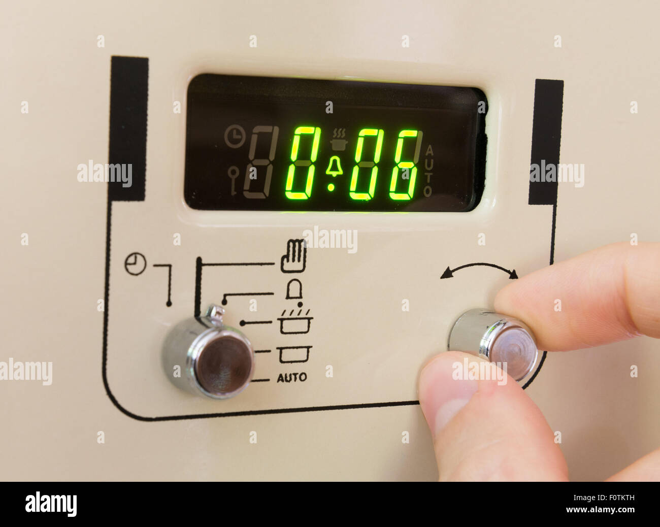 Setting a cooker timer to 6 minutes - Stock Image