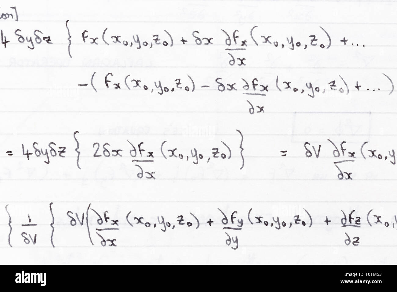 Hand written study notes for math with equations for divergence of vector fields - Stock Image