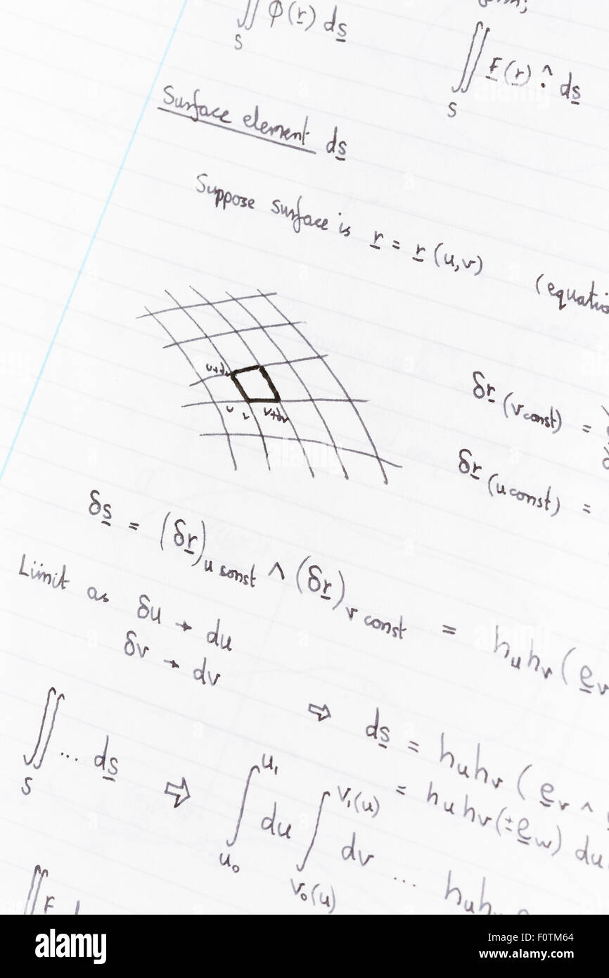 Surface integration equations and diagram for physics handwritten on lined paper - Stock Image