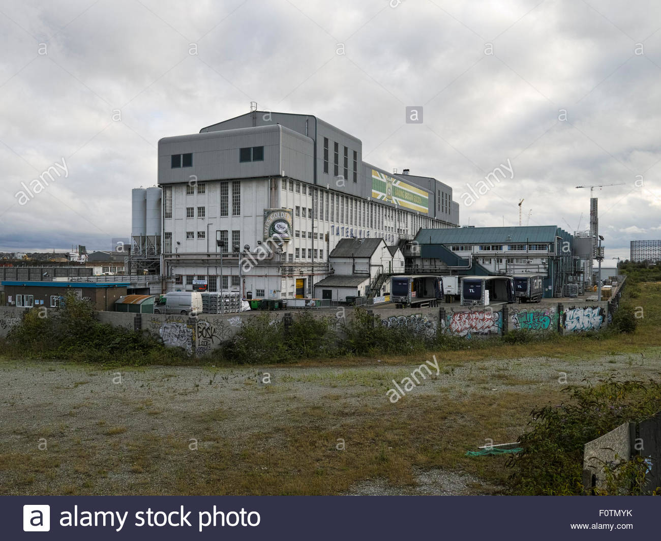 Tate and Lyle factory building and industrial compound at West Silvertown: London. - Stock Image