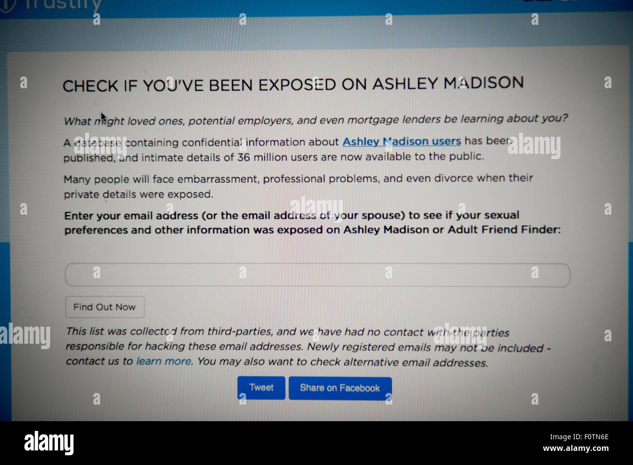 A picture of desktop mac computer displaying a page on Trustify, Check if you've been exposed on ashley madison - Stock Image