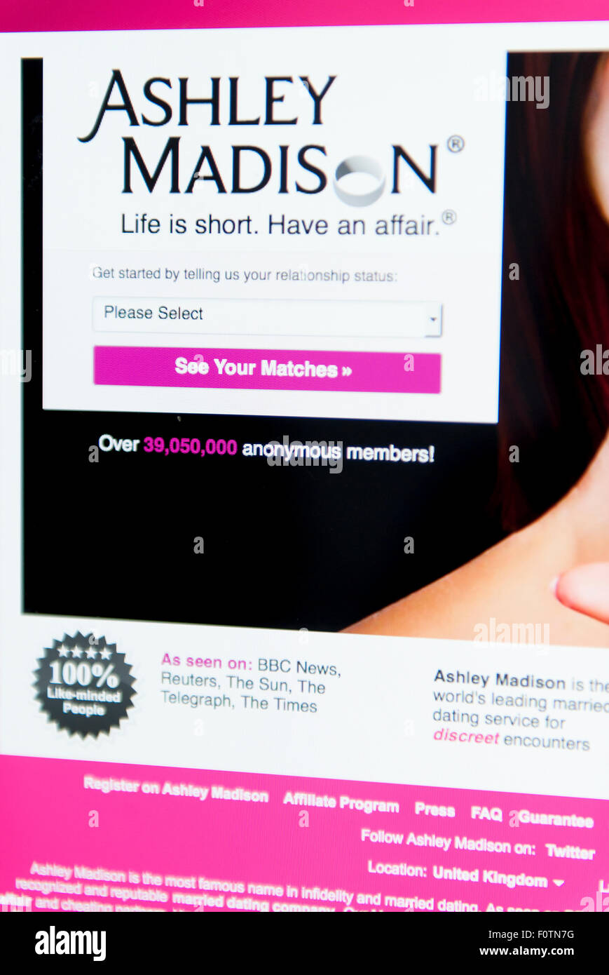 Picture of a desktop mac computer with the front page of the Ashley Madison adultery website - Stock Image
